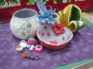 Friday 18th October. Come and have fun  with felt. During the day you will make several of the pieces shown in the picture. Felt is so versatile and once you know how to make it and  create beautiful felt objects the sky is the limit!
