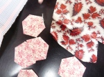 These are hexagons which have been prepared ready to be joined onto the quilt